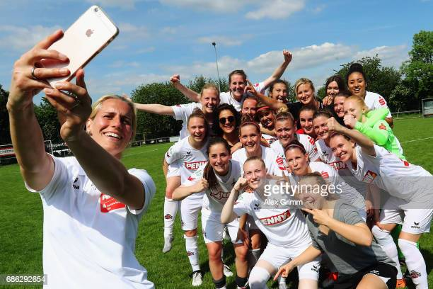Players of Koeln celebrate their Bundesliga promotion after the Second Bundesliga Women South match between FFC Niederkirchen and 1 FC Koeln on May...