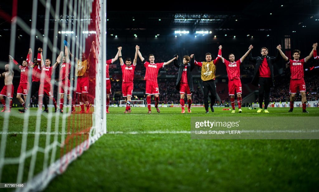 Players of Koeln celebrate their win after the UEFA Europa League group H match between 1. FC Koeln and Arsenal FC at RheinEnergieStadion on November 23, 2017 in Cologne, Germany.