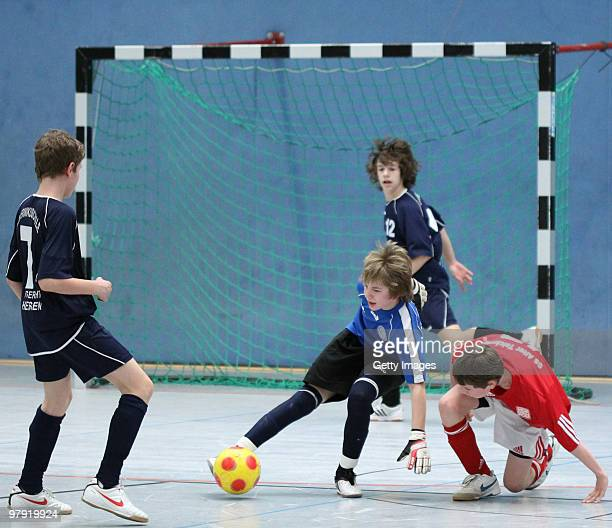 Players of Kopernikusschule Freigericht and Gesamtschule Alter Teichweg in Hamburg fight for the ball during the DFB junior futsal cup finals for...