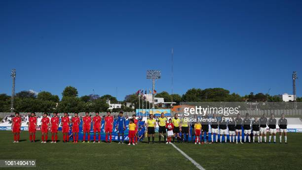 Players of Korea DPR and Germany team line up for the National Anthems ahead the FIFA U17 Women's World Cup Uruguay 2018 group C match between Korea...
