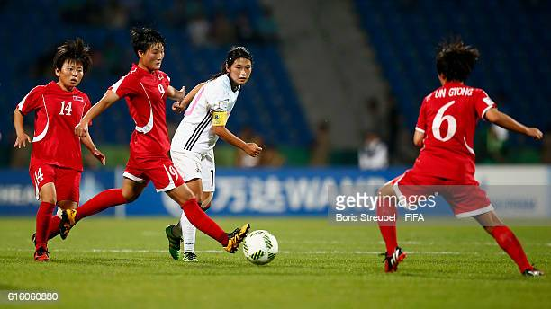 Players of Korea DPR challenge Fuka Nagano of Japan during the FIFA U17 Women's World Cup Finale match between Korea DPR and Japan at Amman...