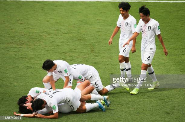 Players of Korea Republic celebrate after scoring their first goal during the match against Angola for the round of sixteen of FIFA U-17 World Cup...