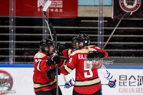 Players of Kunlun Red Star WIH celebrate during the 2017/2018 Canadian Women's Hockey League CWHL match between Kunlun Red Star WIH and Toronto...