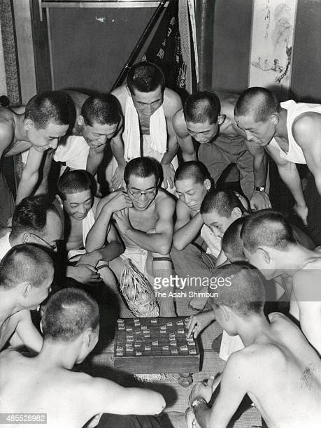 Players of Kyoei Shogyo play Shogi Japanese chess at their accommodation during the 30th Japanese High School Baseball Championship on August 9 1948...