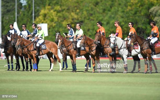 Players of La Dolfina and La Aguada line up for a prayer in honor to the 44 Argentine submarine crew members lost in the South Atlantic the during a...