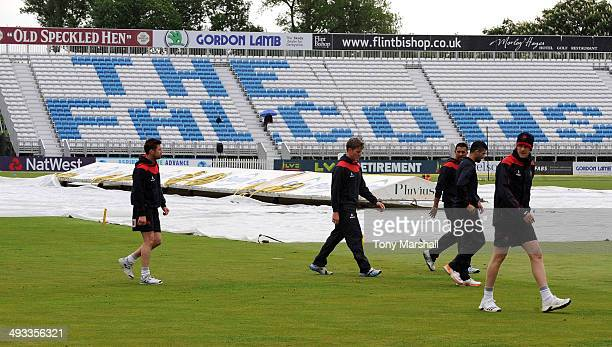 Players of Lancashire Lightning walk in as the rain comes down during the NatWest T20 Blast match between Derbyshire Falcons and Lancashire Lightning...