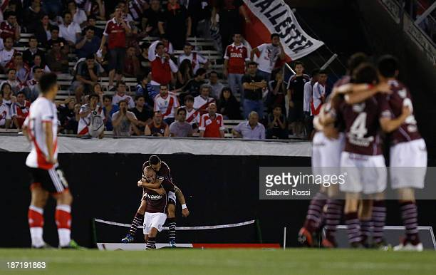 Players of Lanus celebrate a goal during a match between River Plate and Lanus as part of Copa Total Sudamericana at Antonio Vespucio Liberti Stadium...