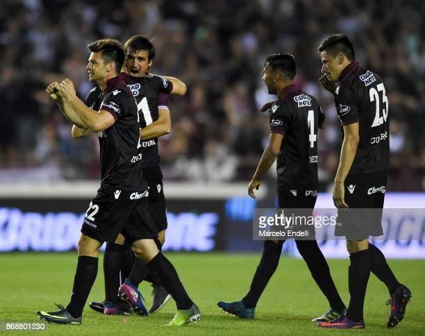 Players of Lanus celebrate after winning a second leg match between Lanus and River Plate as part of the semifinals of Copa CONMEBOL Libertadores...