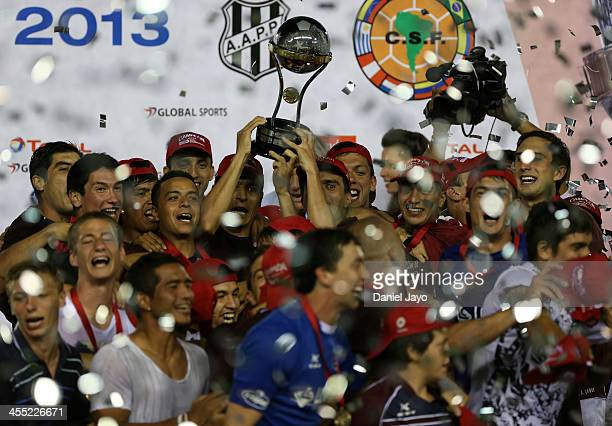 Players of Lanus celebrate at the end of the final match between Lanus and Ponte Preta as part of the Copa TOTAL Sudamericana at Nestor Perez Diaz...