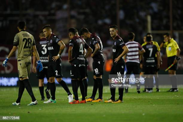 Players of Lanus walk off the field after the first half during the second leg match between Lanus and Gremio as part of Copa Bridgestone...