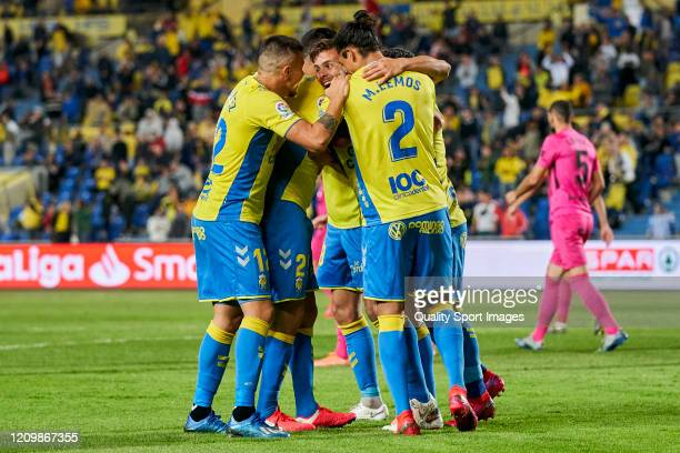 Players of Las Palmas celebrates after scoring his team's first goal during the match between Las Palmas and Malaga at Estadio Gran Canaria on...