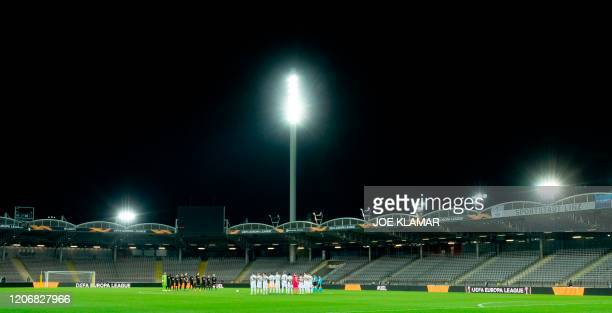 Players of Lask and Manchester United line up prior to the UEFA Europa League last 16 first leg football match Linzer ASK v Manchester United in Linz...