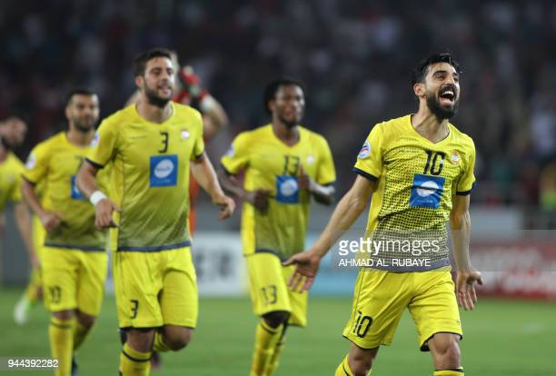 Players of Lebanon's alAhed club celebrate during the AFC Cup football match between Iraq's AlZawraa club and Lebanon's AlAhed club at the Karbala...