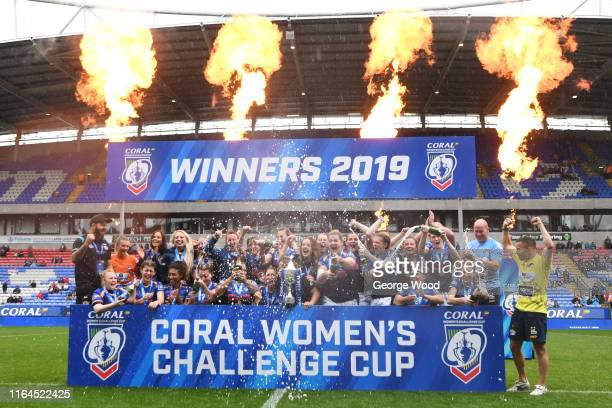 Players of Leeds Rhinos celebrate with the trophy after the Coral Women's Challenge Cup Final between Castleford Tigers and Leeds Rhinos at...