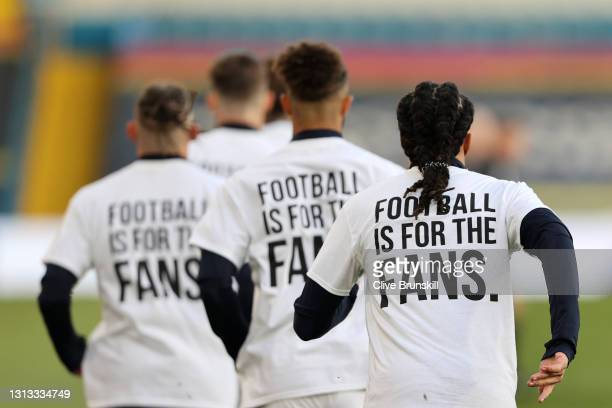 "Players of Leeds United warm up while wearing protest t-shirt's reading ""Football is for the fans"" during the Premier League match between Leeds..."