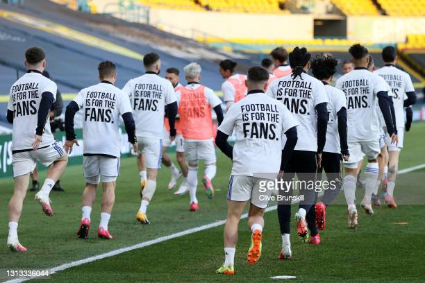 "Players of Leeds United warm up while wearing protest t-shirt's reading ""Football is for the fans"" prior to the Premier League match between Leeds..."