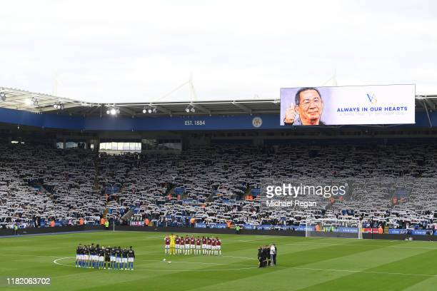 Players of Leicester City and Burnley FC observe a minutes silence for former Leicester City owner Vichai Srivaddhanaprabha prior to the Premier...