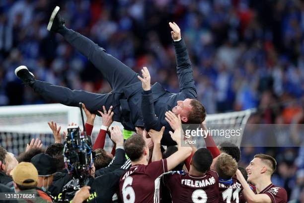 Players of Leicester City throw Brendan Rodgers, Manager of Leicester City in the air after victory in The Emirates FA Cup Final match between...