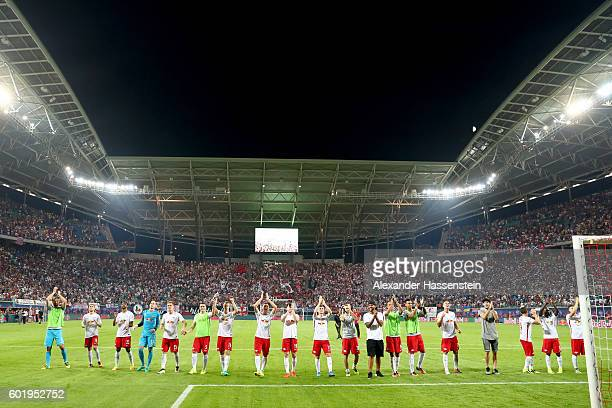 Players of Leipzig celebrate victory after winning the Bundesliga match between RB Leipzig and Borussia Dortmund at Red Bull Arena on September 10...