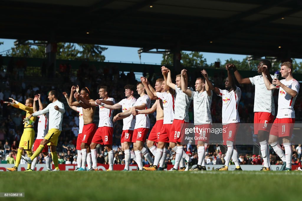 Players of Leipzig celebrate with the fans after the DFB Cup first round match between Sportfreunde Dorfmerkingen and RB Leipzig at Ostalb-Arena on August 13, 2017 in Aalen, Germany.