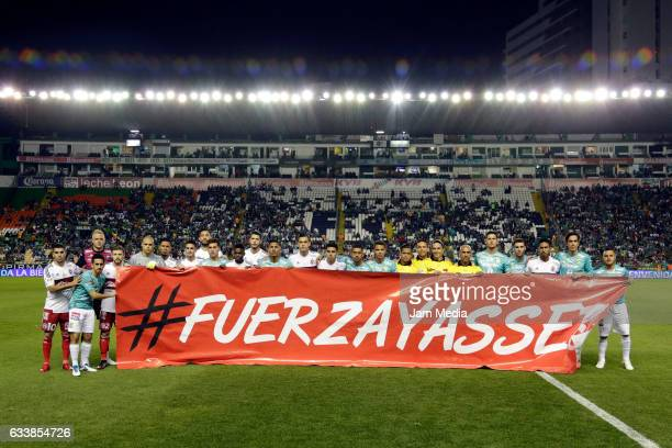 Players of Leon and Tijuana display a banner to support Tijuana's player Yasser Corona prior the 5th round match between Leon and Tijuana as part of...