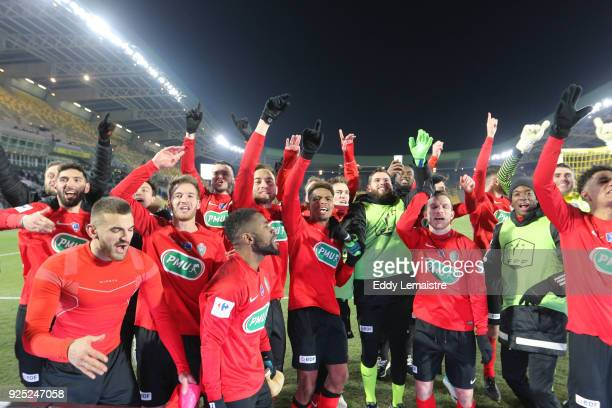 Players of Les Herbiers celebrate after defeating Lens during the French Cup match between Les Herbiers and Lens at Stade de la Beaujoire on February...