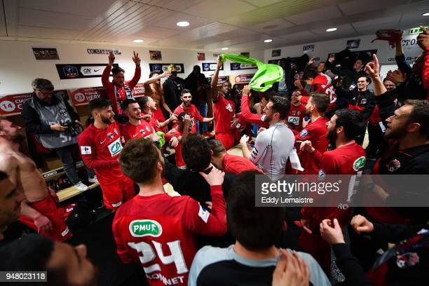 Players of Les Herbiers celebrate in the cloackroom their qualification for the final after defeating Chambly during the French Cup semi final match...