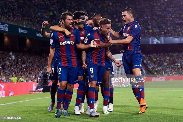 Players of Levante UD celebrate with Roger Marti his side first goal during the La Liga match between Real Betis Balompie and Levante UD at Estadio...
