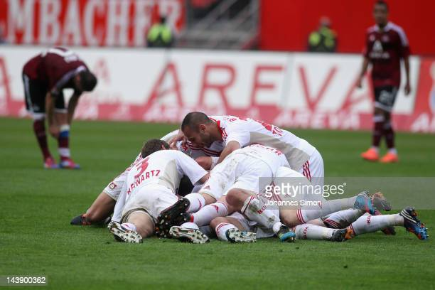Players of Leverkusen celebrate after their team's 4th goal during the Bundesliga match between 1. FC Nuernberg and Bayer 04 Leverkusen at Easy...