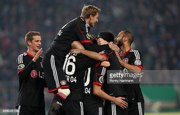 Players of Leverkusen celebrate their team's opening goal during the DFB Cup second round match between 1 FC Magdeburg and Werder Bremen at MDCC...