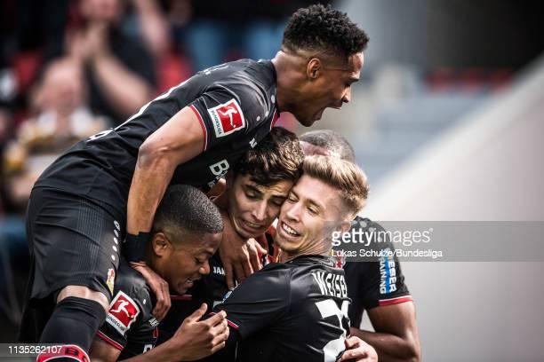 Players of Leverkusen celebrate their team's second goal scored by Kai Havertz of Leverkusen during the Bundesliga match between Bayer 04 Leverkusen...