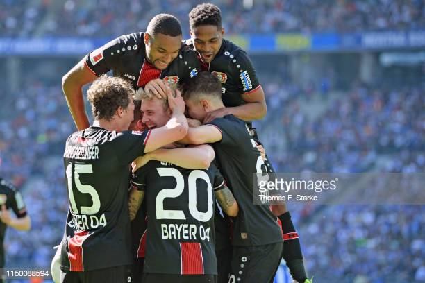 Players of Leverkusen celebrate with Julian Brandt who scored his teams third goal during the Bundesliga match between Hertha BSC and Bayer 04...