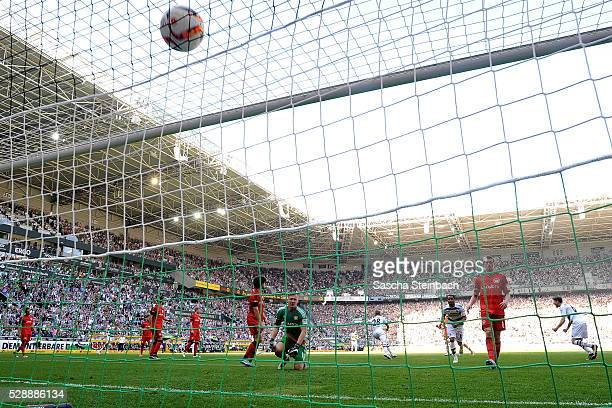 Players of Leverkusen react after Andre Hahn of Moenchengladbach scores his team's first goal during the Bundesliga match between Borussia...