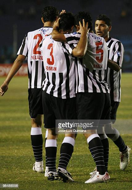 Players of Libertad celebrate scored goal by Adalberto Roaman during a match against Blooming at Ramon Aguilera Costa Stadium on April 15 2010 in...