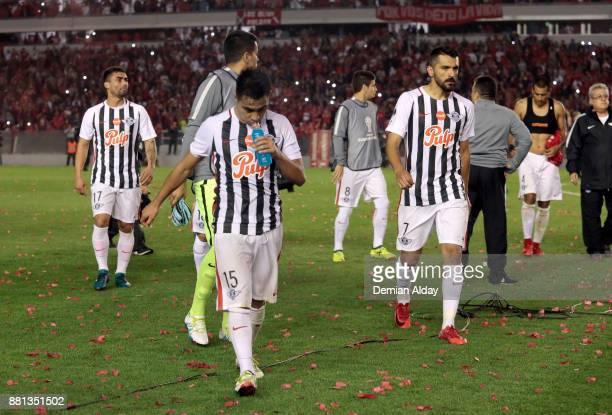 Players of Libertad look dejected after losing a second leg match between Independiente and Libertad as part of the semifinals of Copa CONMEBOL...