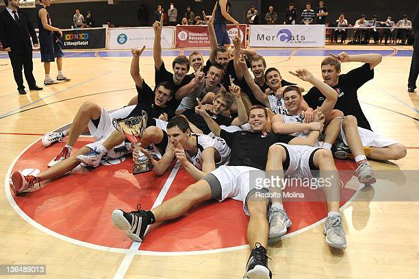 Players of Lietuvos Rytas, pose as the 2012 New Champions, with their Trophy after the Hospitalet Junior Tournament Award Ceremony at Pabellon...