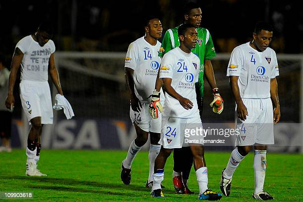 Players of Liga Deportiva Universitaria de Quito leave the field after losing against Penarol a match as part of the Santander Libertadores Cup 2011...