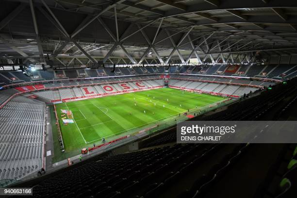 Players of Lille and Amiens compete behind closed doors on April 1 2018 during their French L1 football match at the grand Stade PierreMauroy in...