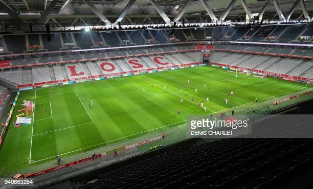 Players of Lille and Amiens compete behind closed doors on April 1, 2018 during their French L1 football match at the grand Stade Pierre-Mauroy in...