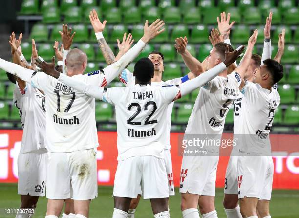 Players of Lille celebrate the goal of Mehmet Zeki Celik during the Ligue 1 match between FC Metz and Lille OSC at Stade Saint-Symphorien on April 9,...