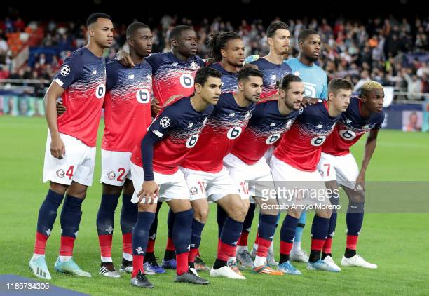 Players of Lille OSC pose for a team photo prior to the UEFA Champions League group H match between Valencia CF and Lille OSC at Estadio Mestalla on...