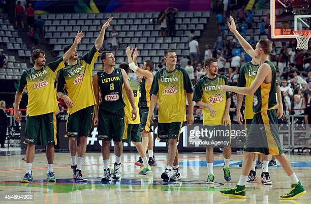 Players of Lithuania celebrate after winning the 2014 FIBA World basketball championships round of 16 match New Zealand vs Lithuania at the Palau...