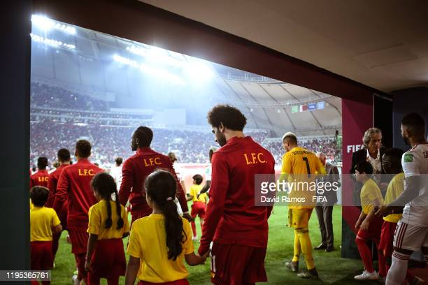 Players of Liverpool and CR Flamengo walk out to the pitch ahead of the FIFA Club World Cup Qatar 2019 Final match between Liverpool FC and CR...