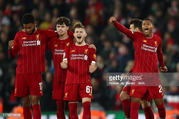 Players of Liverpool celebrate during the penalty shoot out during the Carabao Cup Round of 16 match between Liverpool and Arsenal at Anfield on...