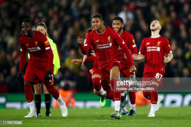 Players of Liverpool celebrate winning the penalty shoot out during the Carabao Cup Round of 16 match between Liverpool and Arsenal at Anfield on...