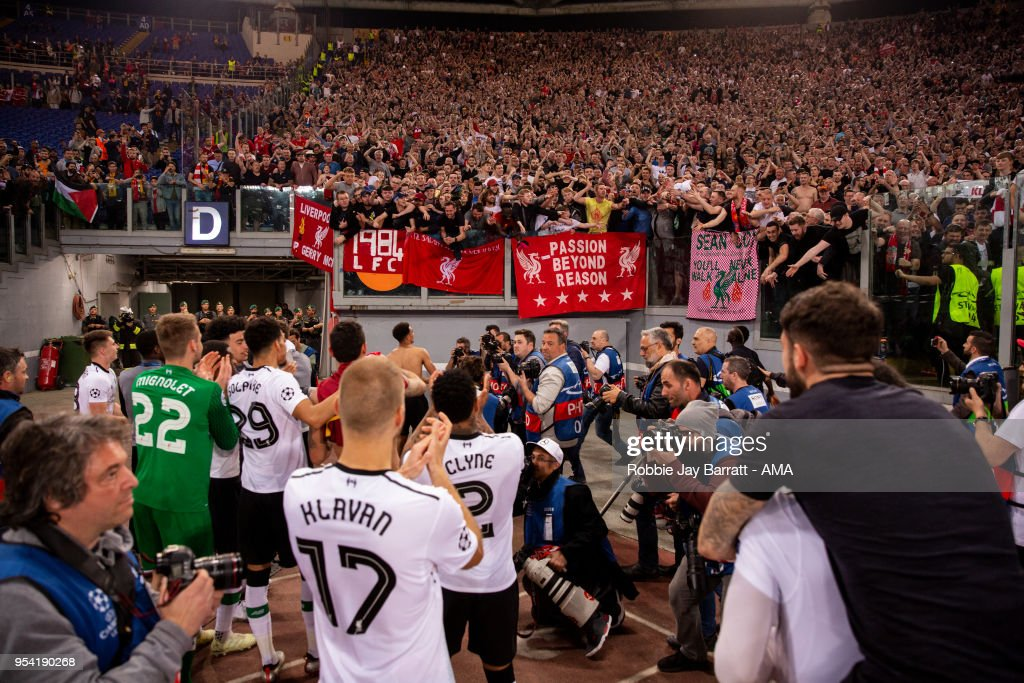 Players of Liverpool celebrate with the fans at full time during the UEFA Champions League Semi Final Second Leg match between A.S. Roma and Liverpool at Stadio Olimpico on May 2, 2018 in Rome, Italy.