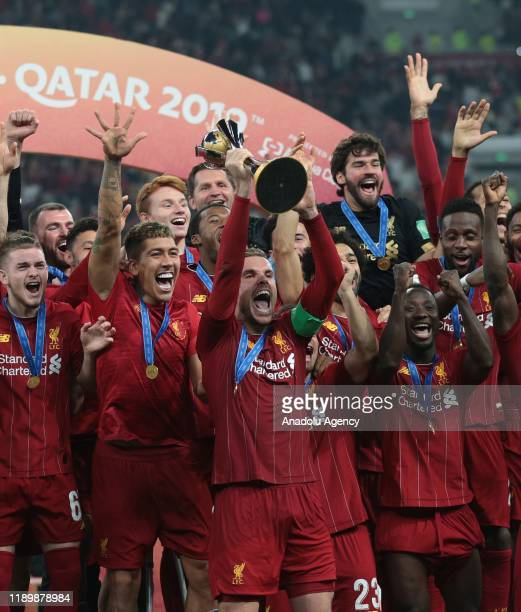 Players of Liverpool lift the trophy during a ceremony at the end of the FIFA Club World Cup Qatar 2019 Final match between Liverpool FC and CR...