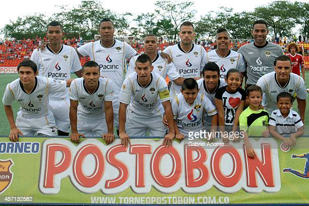 Players of Llaneros FC pose for a team photo prior to a match between America de Cali and Llaneros FC as part of Torneo Postobon 2014 II at Manuel...