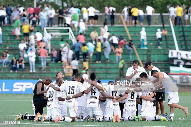 Players of Llaneros FC pray after a match between America de Cali and Llaneros FC as part of Torneo Postobon 2014 - II at Manuel Calle Lombana...