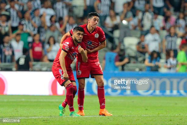 Players of Lobos BUAP look dejected after their team's relegation to second division after the 16th round match between Monterrey and Lobos BUAP as...
